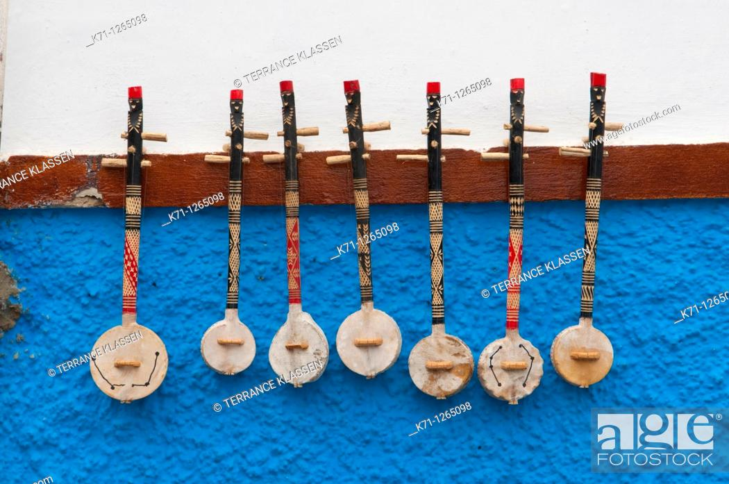 Stock Photo: Stringed musical instruments displayed in the Oudayas Casbah in Rabat, Morocco.