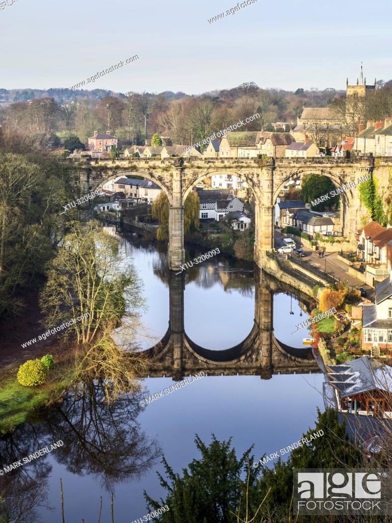 Stock Photo: The railway viaduct reflected in the River Nidd on a sunny winter day at Knaresborough North Yorkshire England.