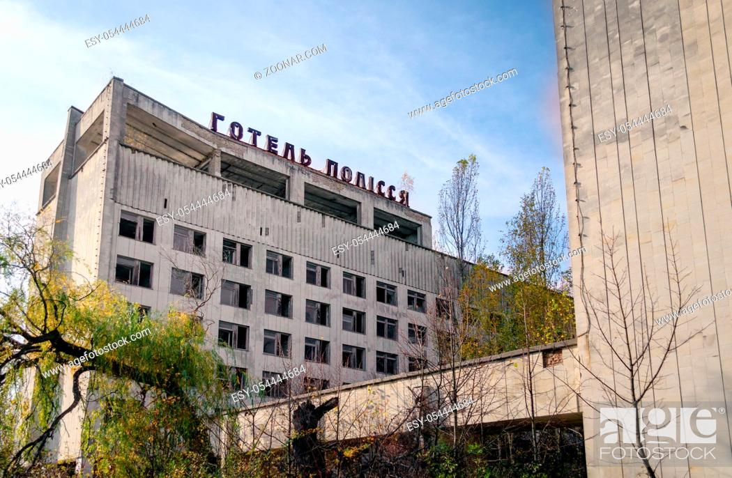 Stock Photo: russian letters the word hotel on the roof of an abandoned building in Chernobyl Ukraine.