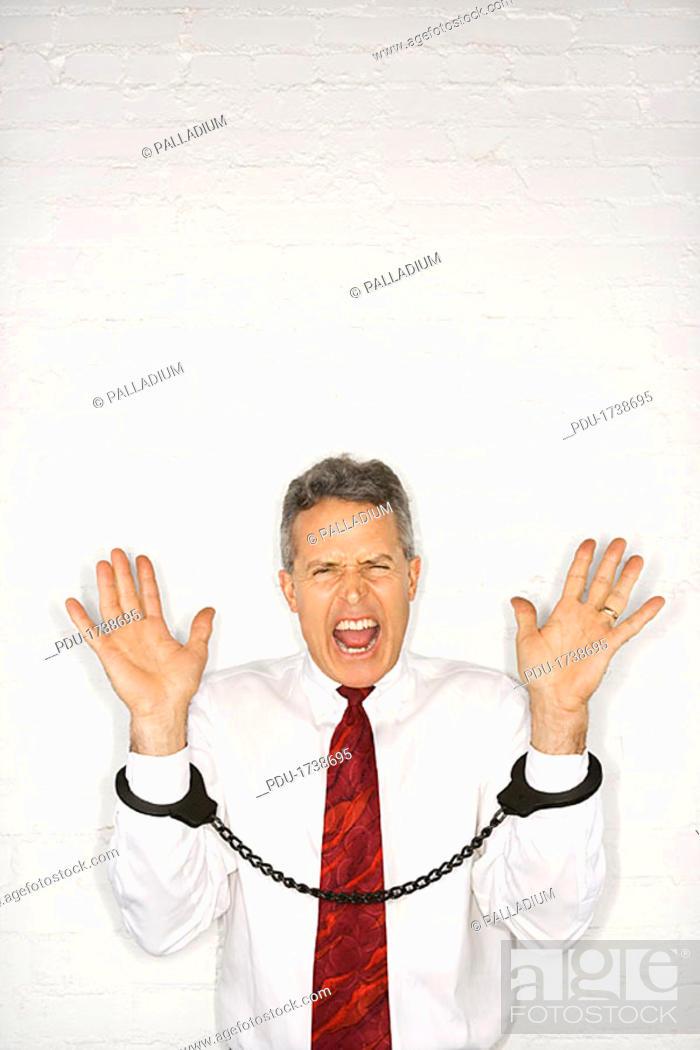 Stock Photo: Handcuffed Businessman.
