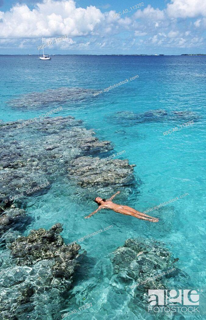 Naked woman in the sea Manihi Island Tahiti French