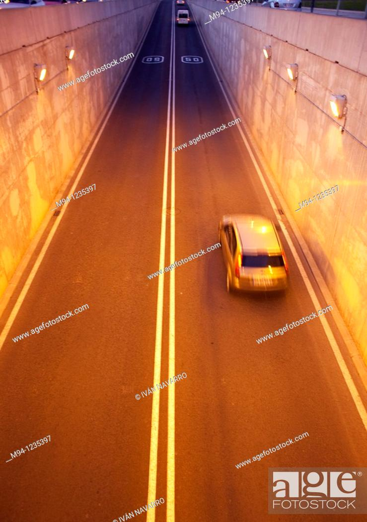 Stock Photo: cars and motorcycles passing through a tunnel.