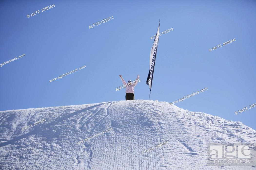Stock Photo: Girl at The Top of a Hill.