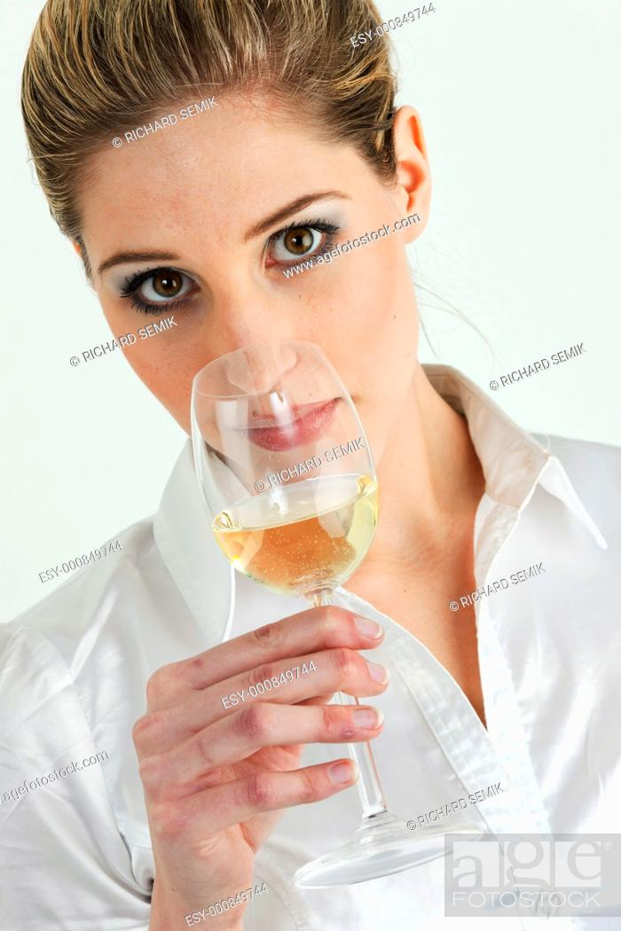 Stock Photo: portrait of young woman tasting white wine.