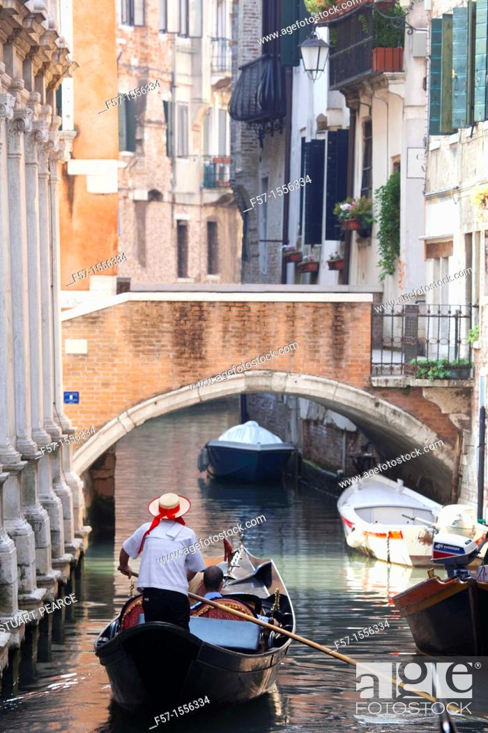Stock Photo: Gondolas on the narrow canals of Venice, Italy.