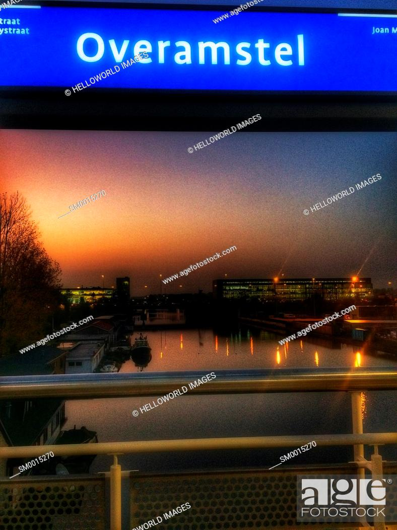 Stock Photo: Canal at dawn, Overamstel, Amsterdam, Netherlands.