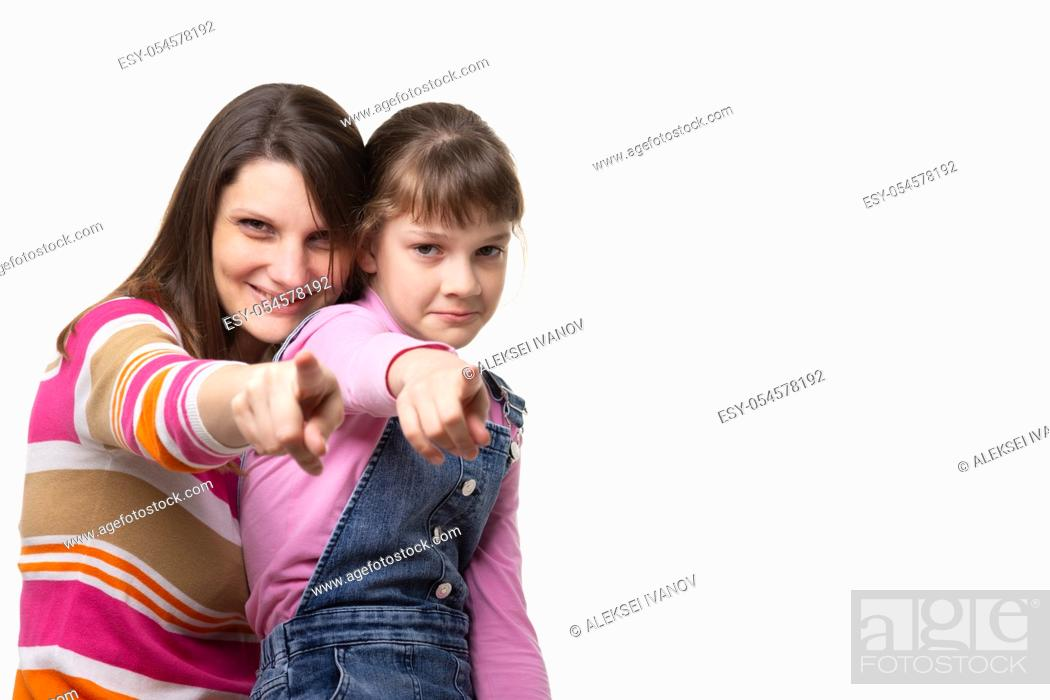 Stock Photo: Mom and daughter point a finger at the frame, side empty space in the frame.