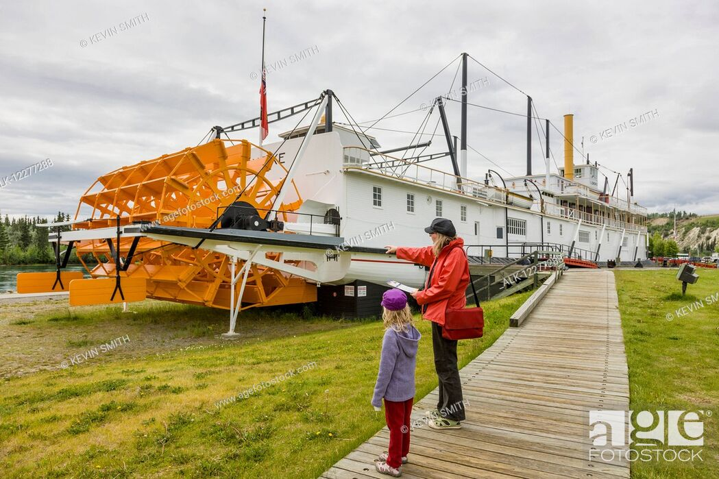 Imagen: Mother and daughter stand on a boardwalk looking at the SS Klondike, Whitehorse, Yukon Territory, Canada, summer.