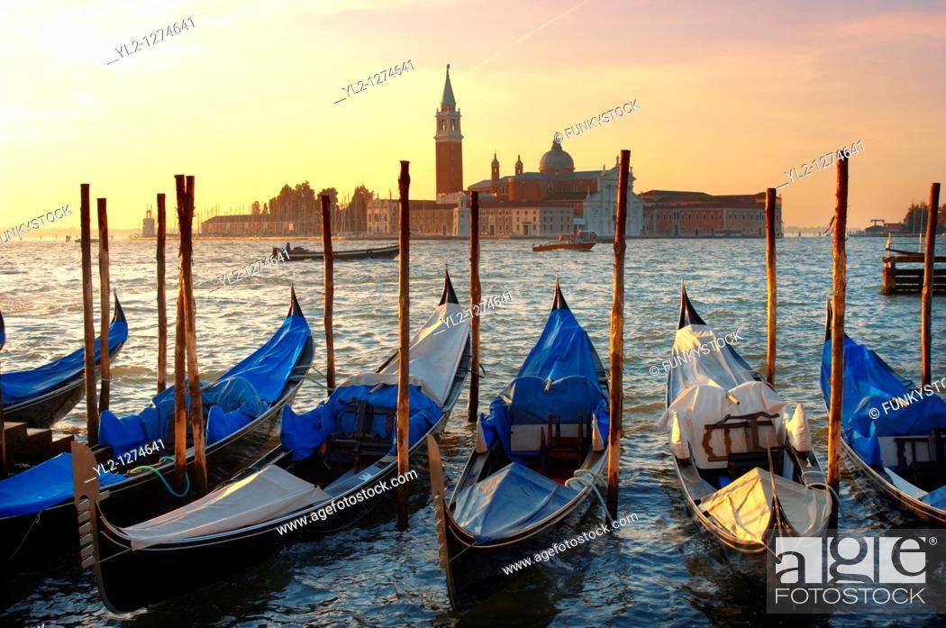 Stock Photo: Gondolas in the early morning sun - Vnice Italy.