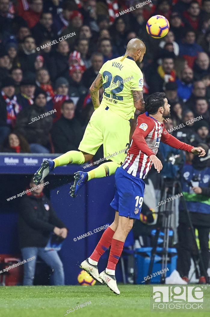 Stock Photo: Arturo Vidal (midfielder; Barcelona), Diego Costa (forward; Atletico Madrid) before La Liga match between Atletico de Madrid and F.C.