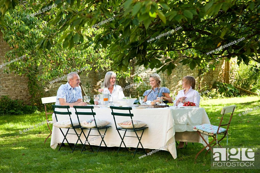 Stock Photo: Family having lunch outdoors.