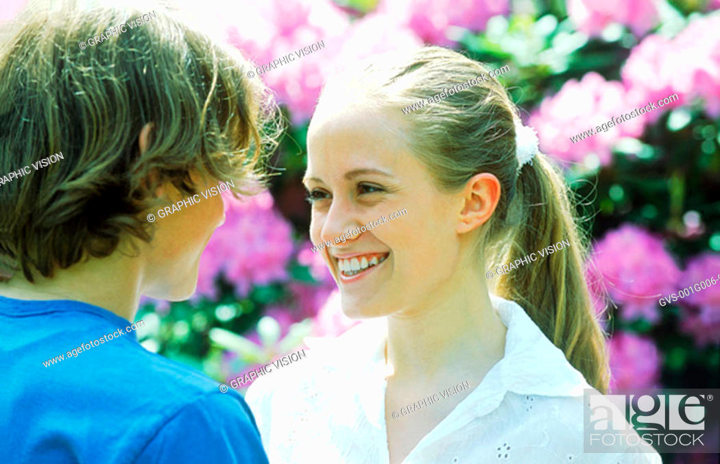 Stock Photo: Young couple smiling looking at each other.