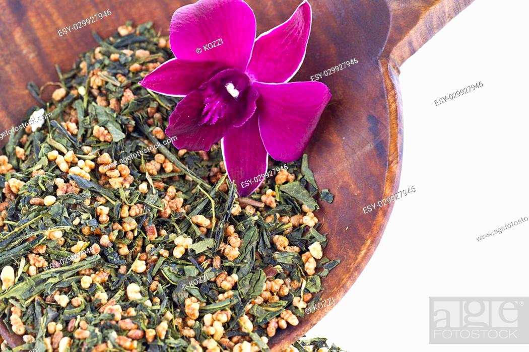 Stock Photo: Close-up shot of pink flower and dried tea leaves.
