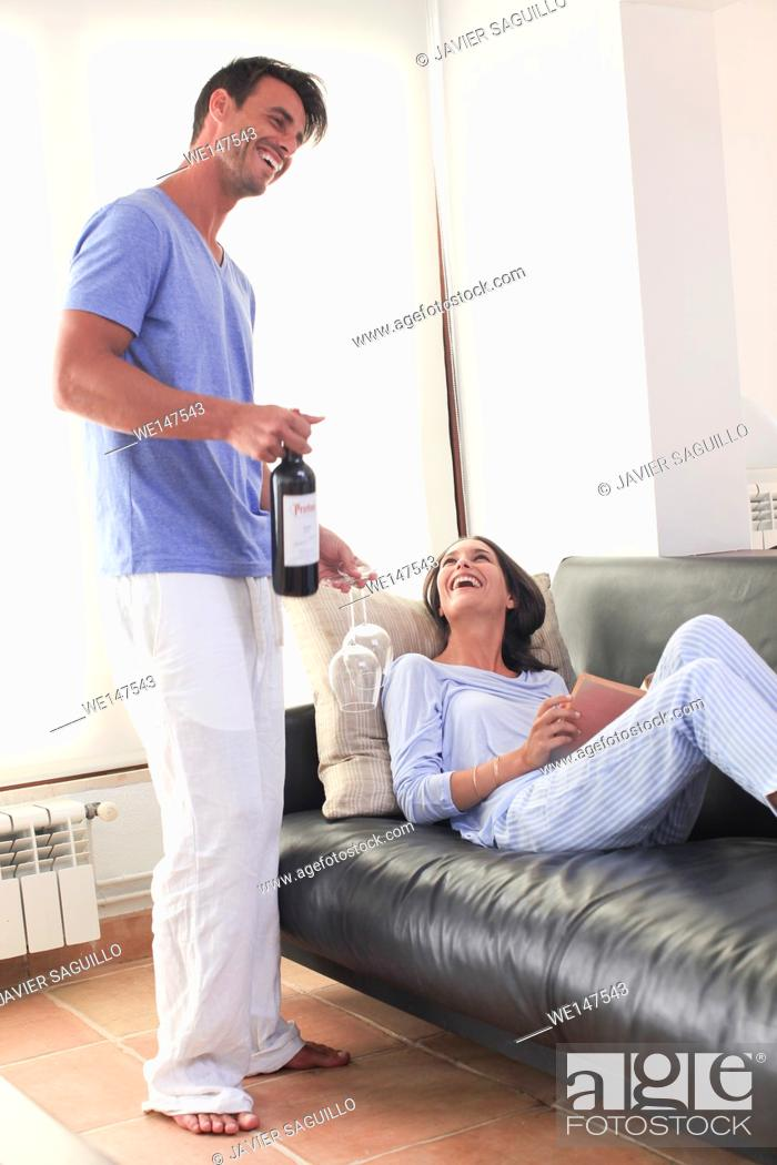 Stock Photo: Couple with bottle of red wine.