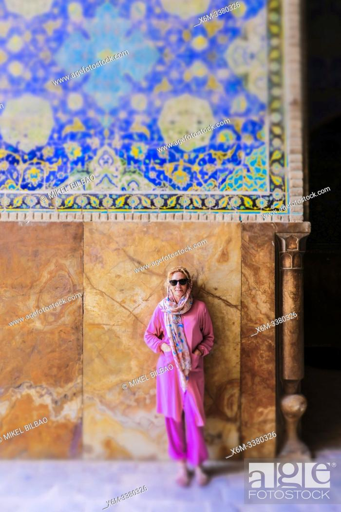 Stock Photo: Woman in Shah Mosque. Naghsh-e Jahan Square. Isfahan, Iran. Asia.