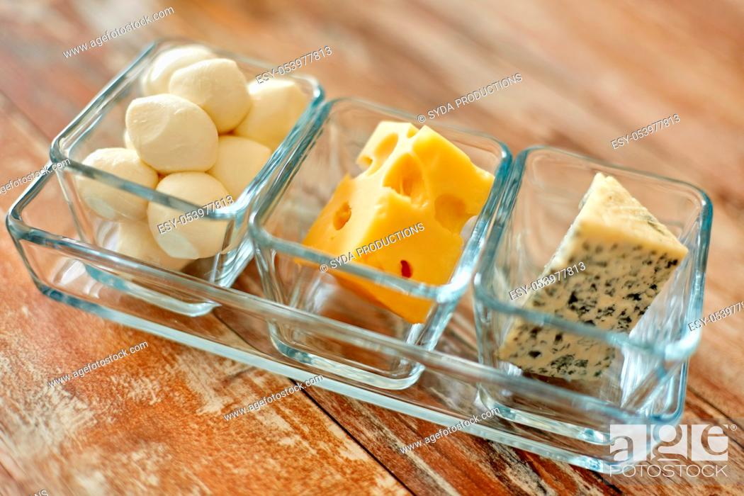 Stock Photo: different kinds of cheese in glass cups.