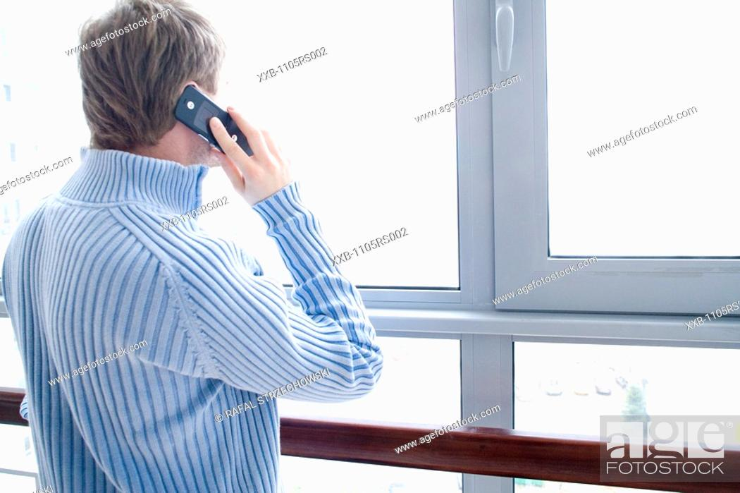 Stock Photo: man using cell phone.