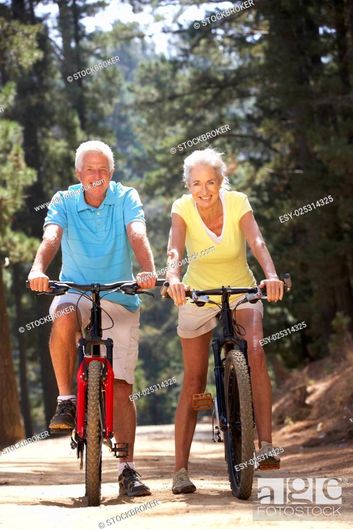 Stock Photo: Senior couple on country bike ride.