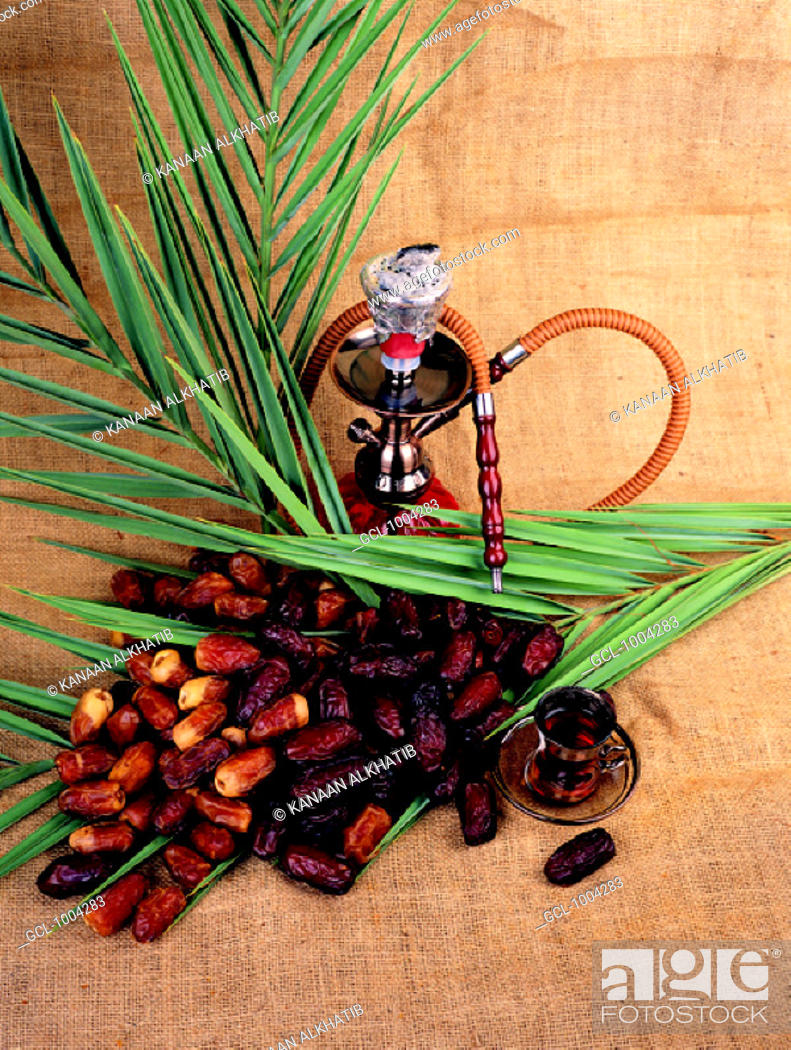 Stock Photo: Arab traditions - sheesha, dried dates and tea.