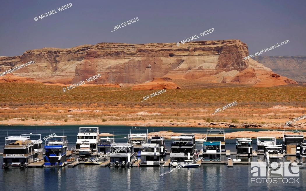 Stock Photo: House boats are moored in the harbour of Antelope Point Marina with Tower Butte at back, Lake Powell, Wahweap Marina, Glen Canyon National Recreation Area, Page.