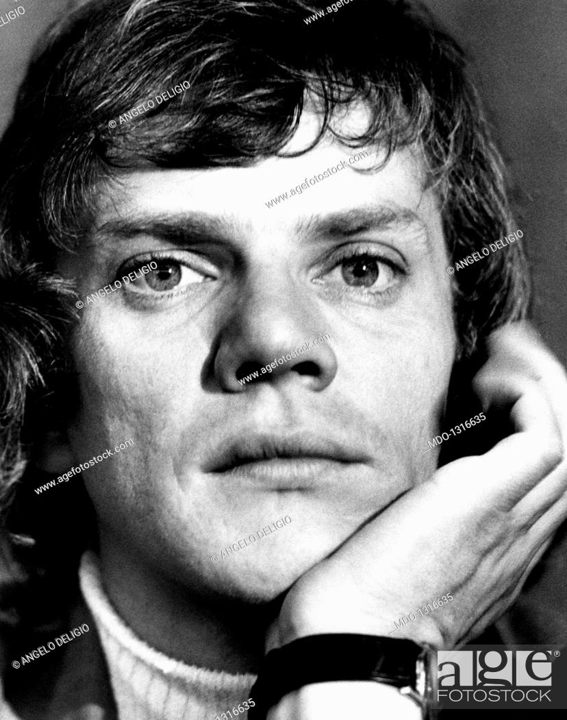 Stock Photo: An intense close-up of Malcolm McDowell. Malcolm McDowell leaning his head on his hand posing for the photographer. Cannes, France, May 1973.