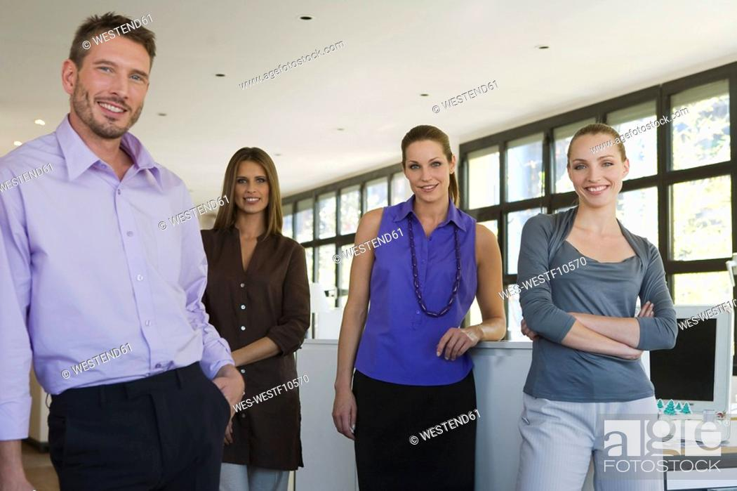 Stock Photo: Four business people in office.