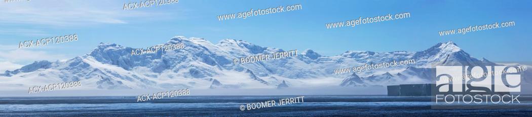 Stock Photo: A tabular iceberg in Bransfield Strait floats past a glaciated land form on the Antarctic Peninsula, near Brown Bluff, Antarctic Peninsula, Antarctica.