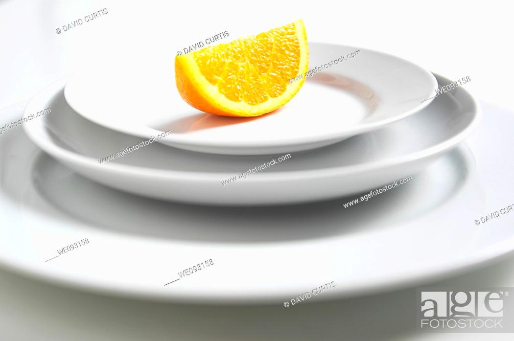 Stock Photo: Orange segment on a plate.