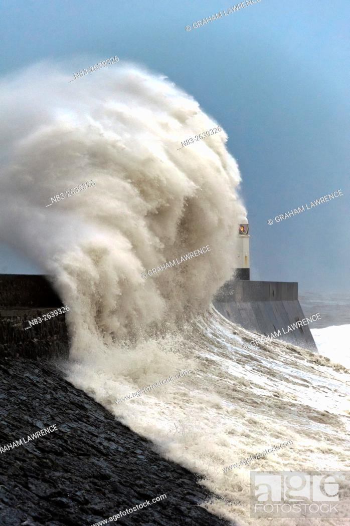 Stock Photo: Huge waves crash against the harbour wall at Porthcawl, Bridgend, Wales, UK.