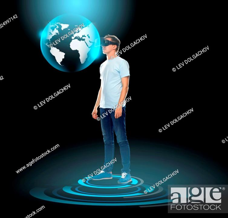 Stock Photo: 3d technology, gaming, augmented reality, cyberspace and people concept - happy young man with virtual reality headset or 3d glasses looking at earth globe.