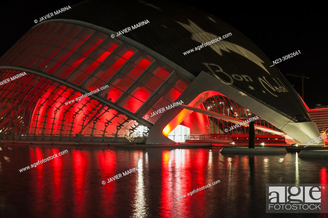 Stock Photo: Hemisferic building illuminated in the city of arts and sciences, behind the building Torre de Francia, Valencia, Spain.
