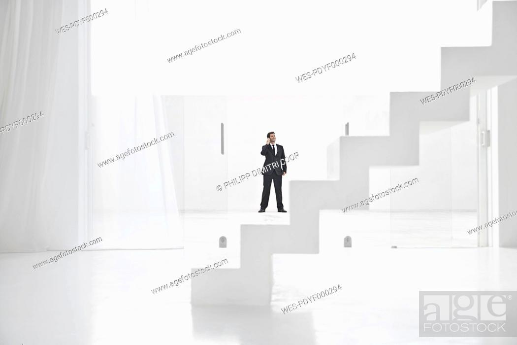 Stock Photo: Spain, Businessman talking on mobile phone.