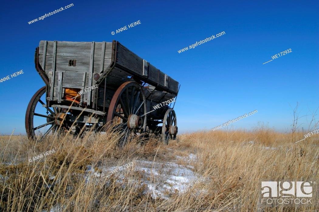 Stock Photo: Abandoned old horse-drawn carriages on farmland. Along Cowboy Trail (Hwy 22) near Longview. Rocky Mountains in background.