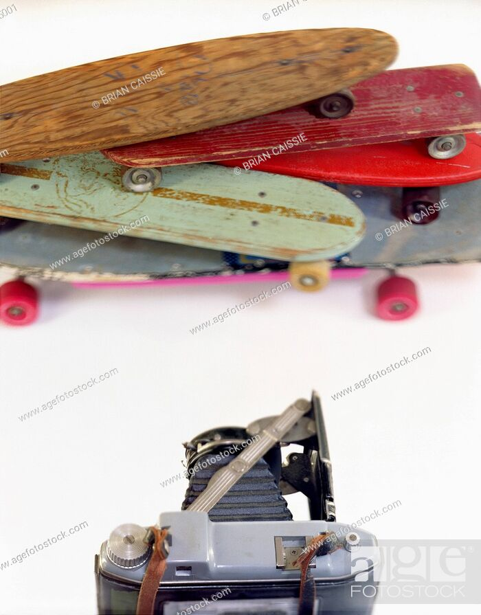 Stock Photo: A large format camera and skateboards in a photo studio.