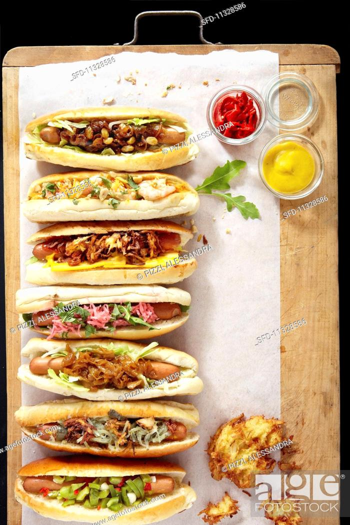 Stock Photo: Various hot dogs in a row (seen from above).