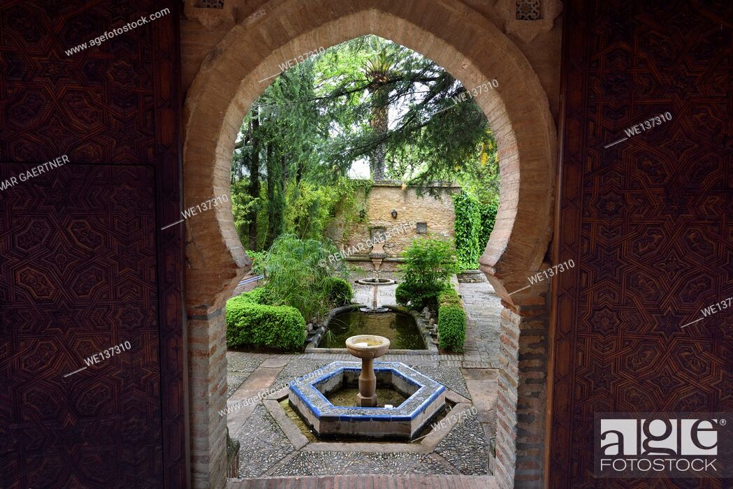 Stock Photo: Ornately carved door to fountain gardens at Mondragon Palace Ronda Museum Spain.