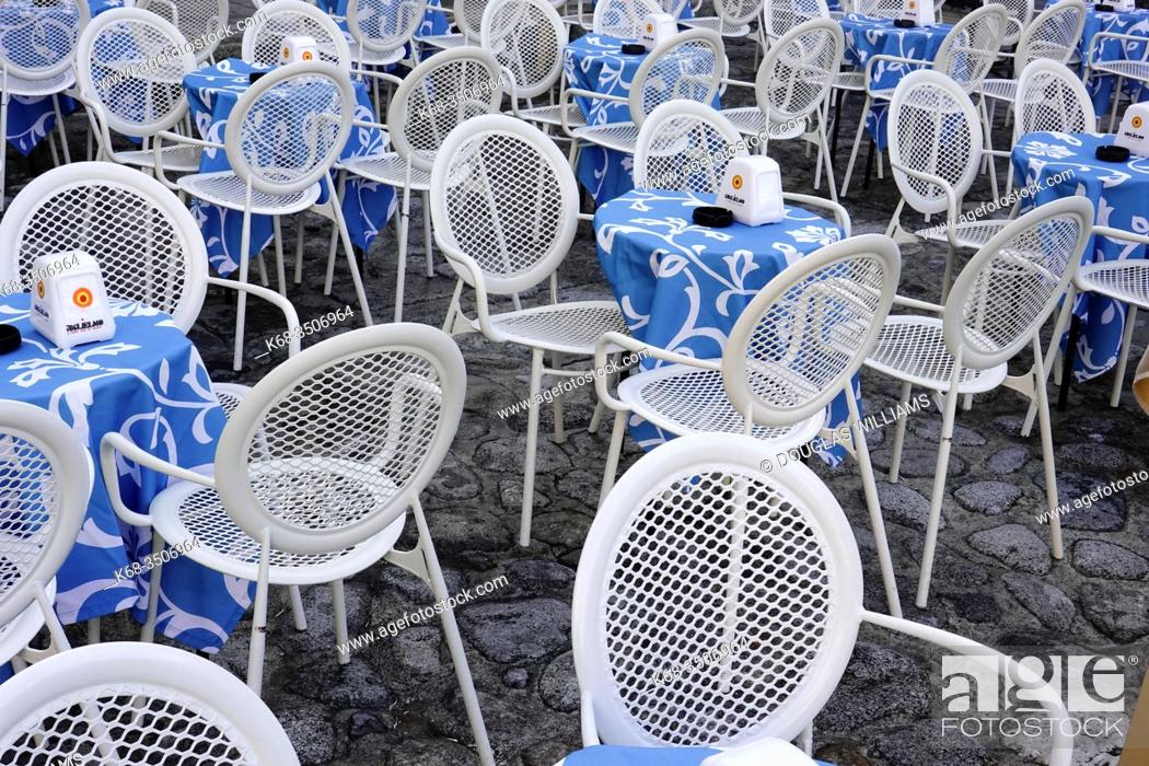 Stock Photo: Tables and chairs at a closed restaurant in Tropea, Italy.
