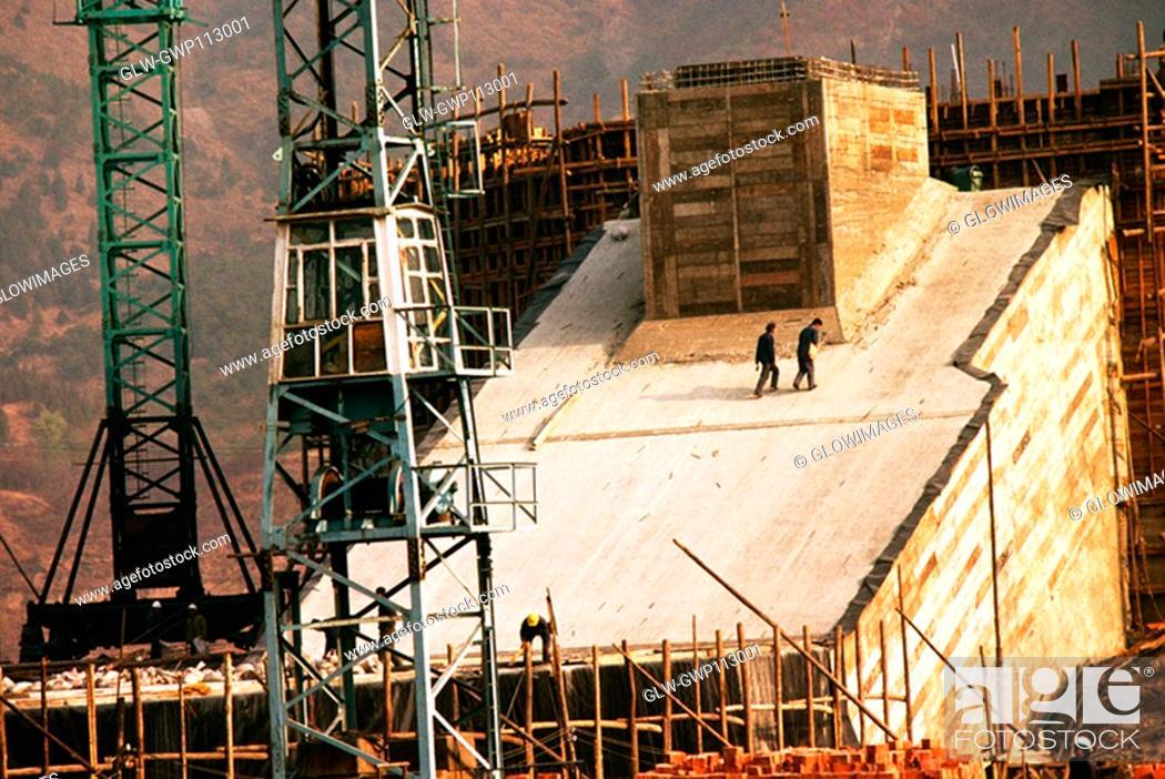 Stock Photo: Crane at a under construction dam, China.