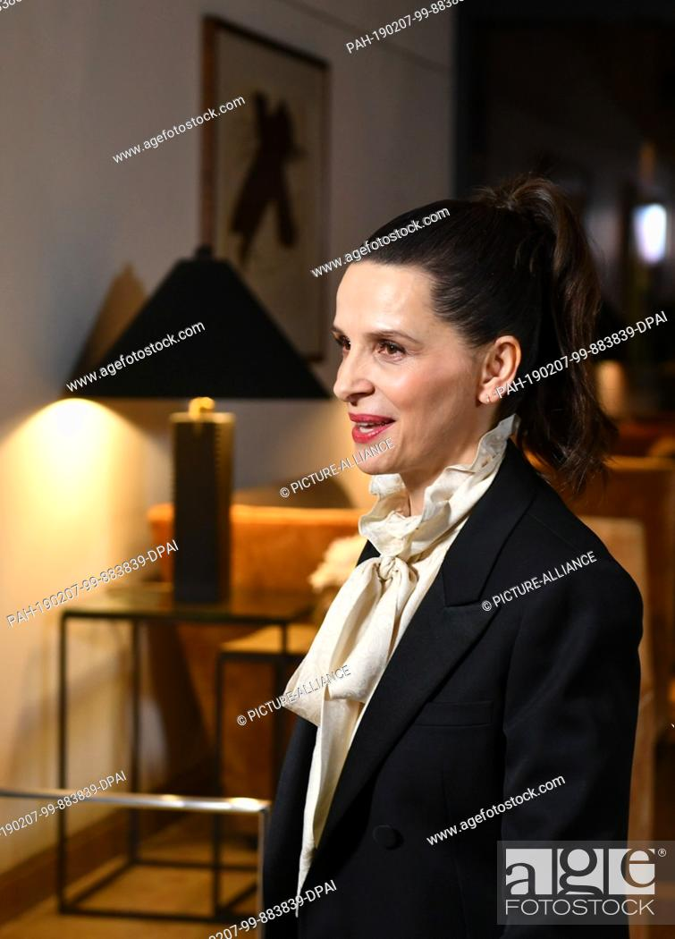 Stock Photo: 06 February 2019, Berlin: Juliette Binoche, French actress and jury president of the Berlinale, comes to the Hotel Mandala for a jury dinner before the start of.