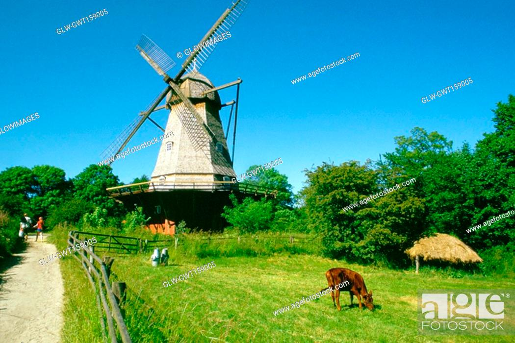 Stock Photo: Low angle view of a windmill on a landscape, Copenhagen, Denmark.