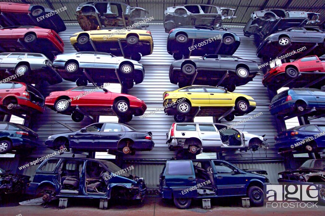 Stock Photo: Disused cars on junkyard, neatly stacked.