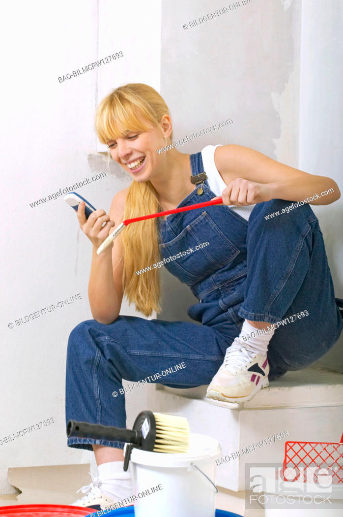 Stock Photo: woman craftwoman having a break at the working site.