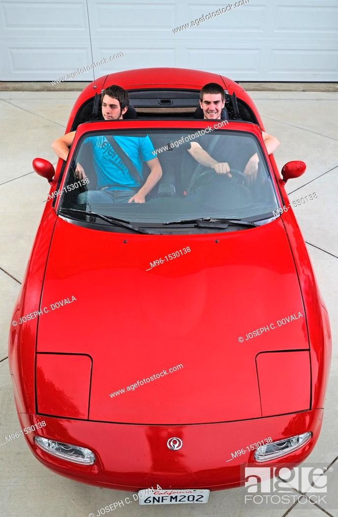 Stock Photo: Teenage males taking new car for test drive, Thousand Oaks, California, USA.