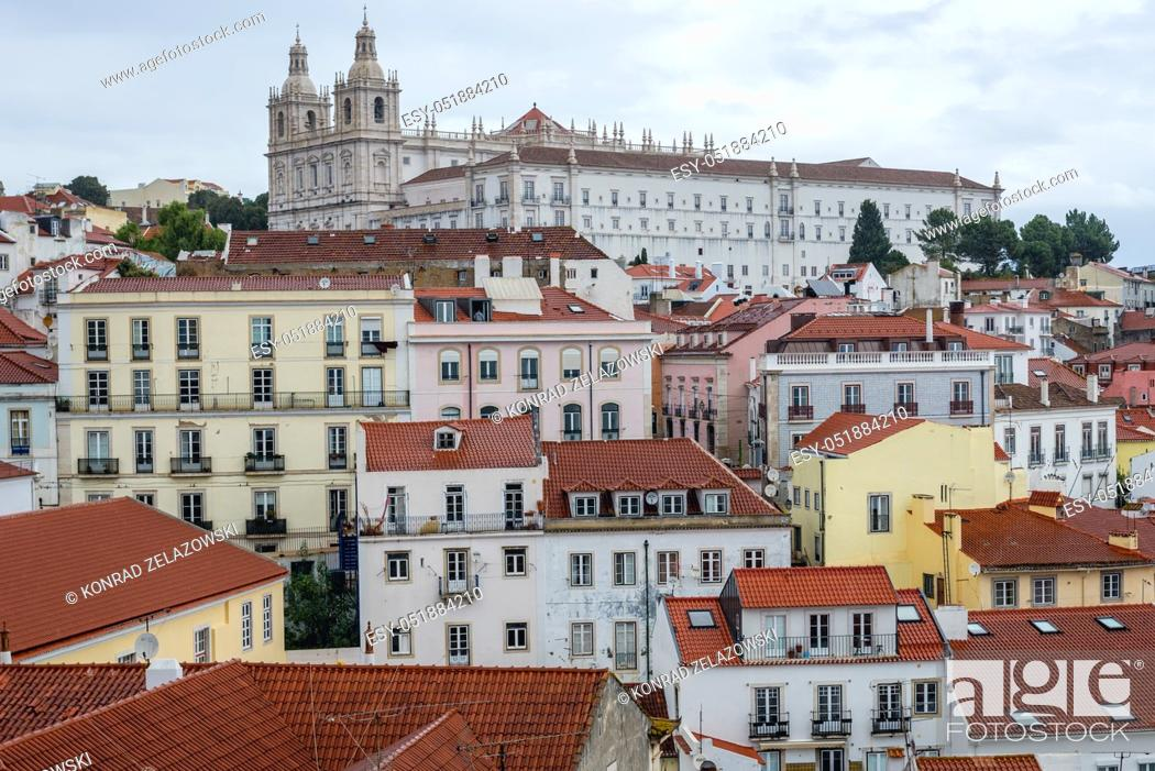 Stock Photo: Aerial view from Miradouro das Portas do Sol in Alfama district of Lisbon city, Portugal. Monastery of Sao Vicente de Fora on background.