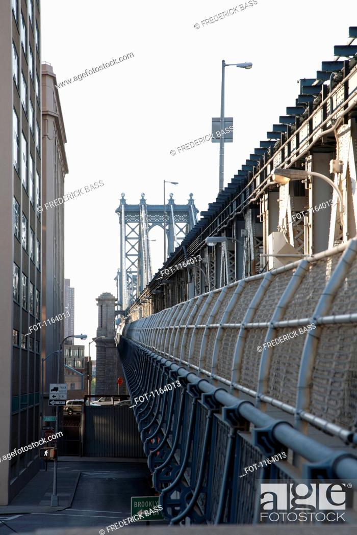 Stock Photo: Outer barrier of Manhattan Bridge with road below.
