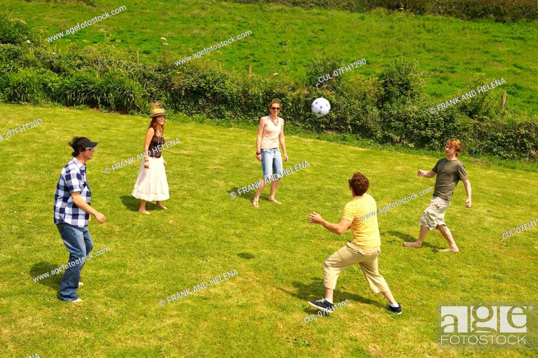 Stock Photo: Group of five people playing football.