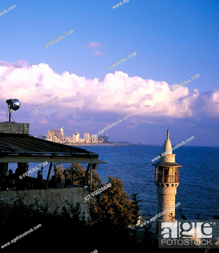 Stock Photo: Israel, glimpse of Tel Aviv from Jaffa, minaret in the foreground.