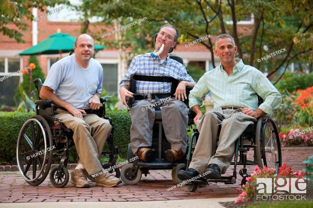 Stock Photo: Three men sitting in wheelchairs.