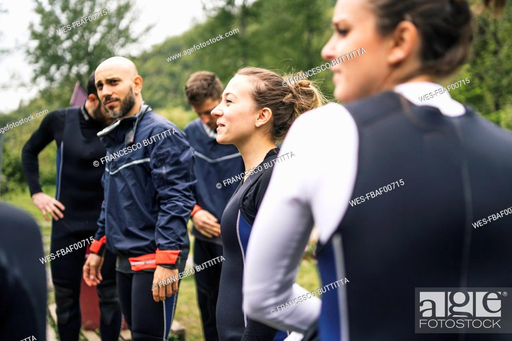 Stock Photo: Group of friends preparing for a boat trip.