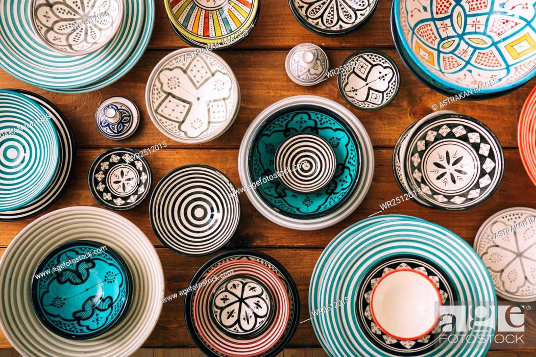 Stock Photo: Directly above shot of multi colored bowls on wooden table.